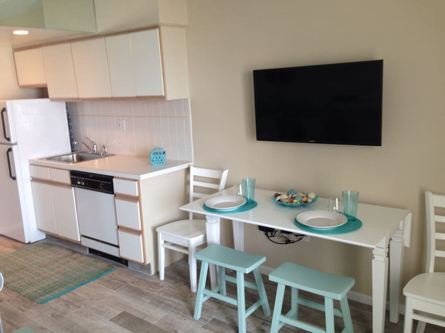Table pulls out and seats 4. Kitchen is fully equipped with fridge, dishwasher, microwave and regular oven. Dishes, utensils and other essentials are included.