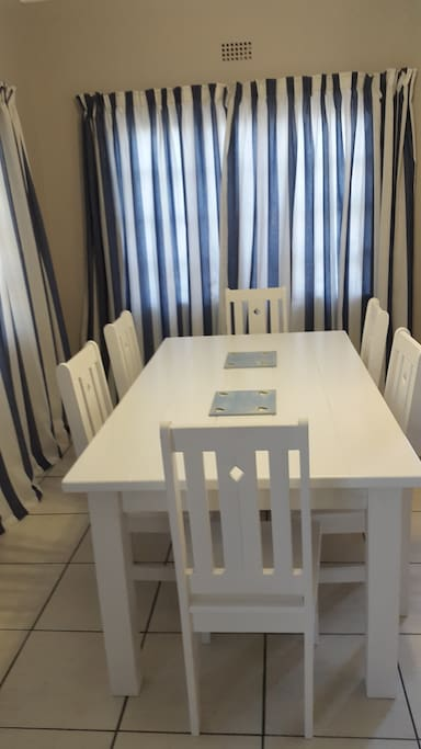 An 8 seater dining room table .