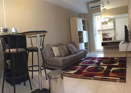 Cozy and Minimalist Apartment in Summarecon Bekasi