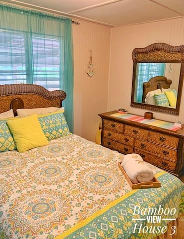 Queen bed AC in room.