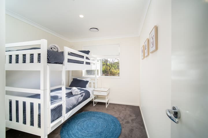 Bed 3 with King Single bunks & a 3rd Single trundle bed, air conditioning & full views of Edwards Point Reserve..
