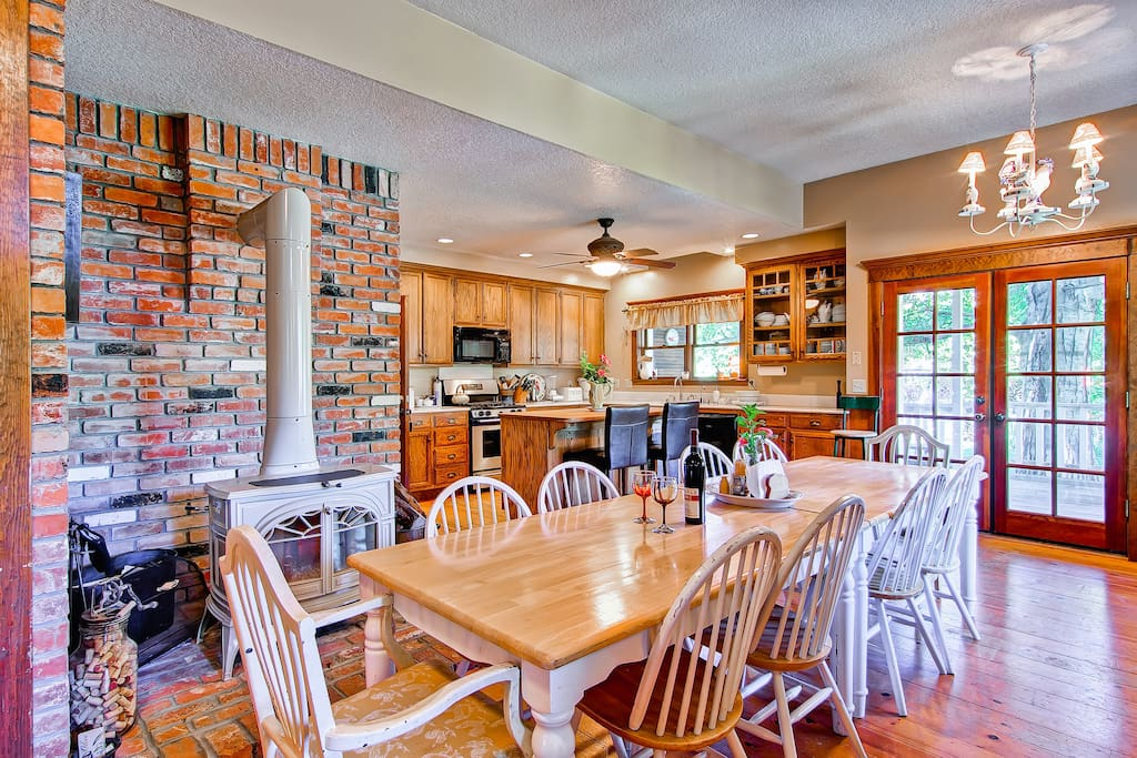 Large Dining Room Table with Brick Fireplace