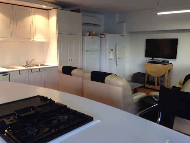 Downstairs kitchen full equipped with Foxtel on TV