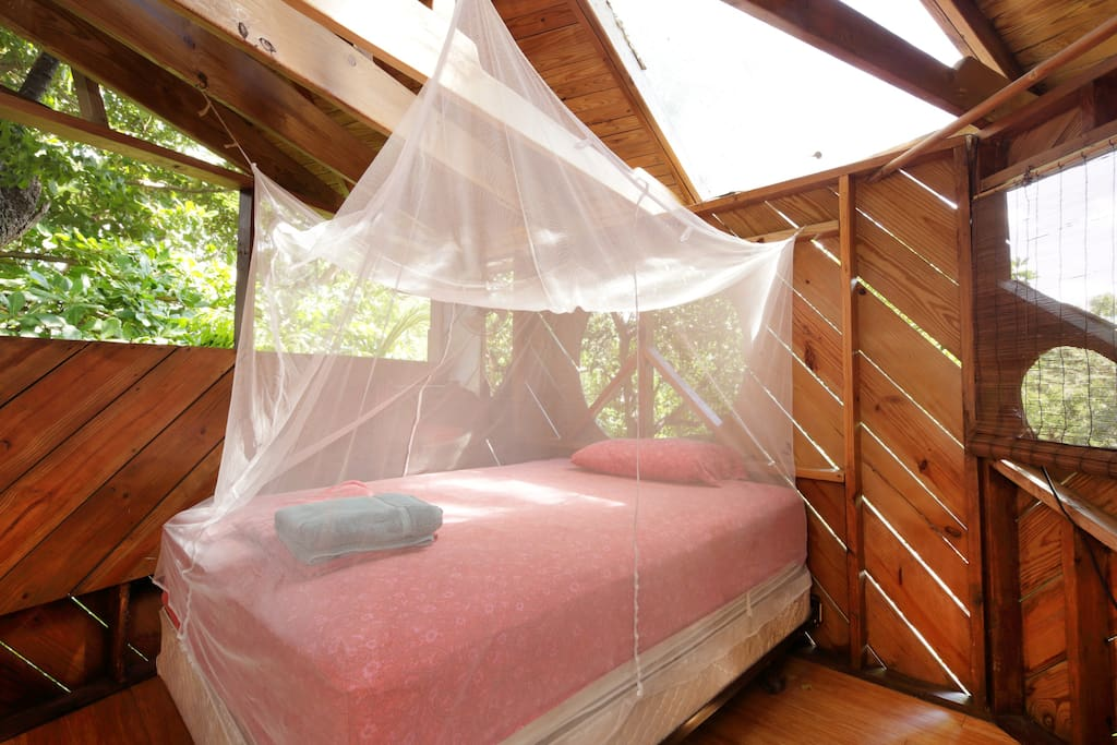 double bed under mosquito net