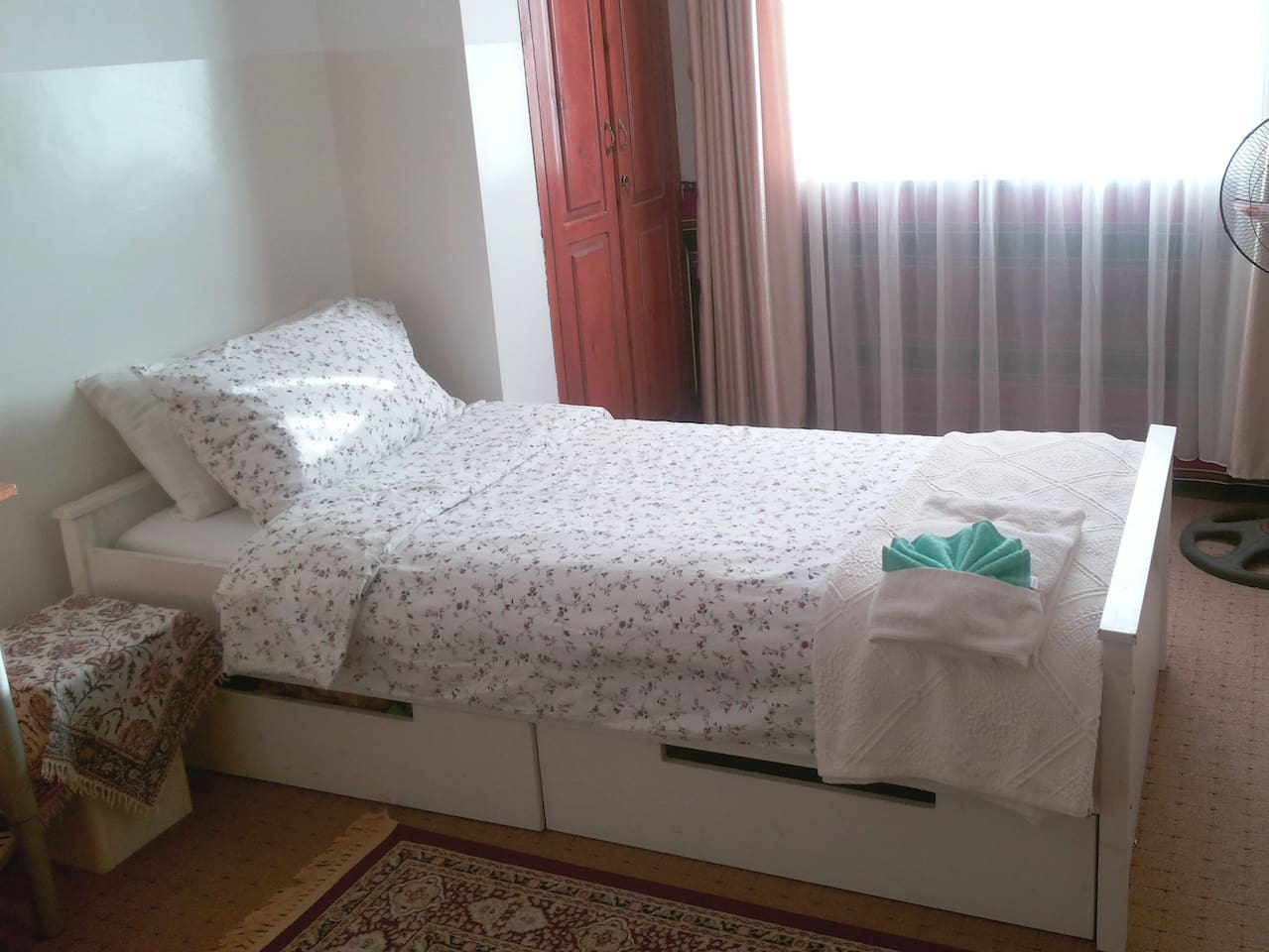 Bright sunny room with comfortable bed