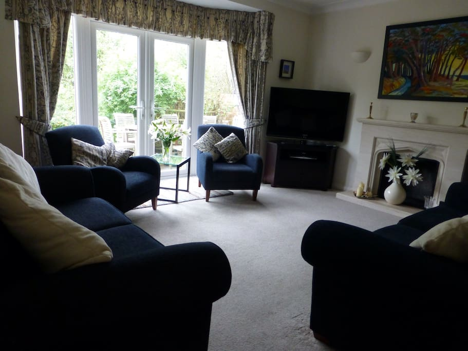 Large south facing sitting room with French windows opening onto a sunny terrace. Large flat screen TV with sky satellite service.sports and the latest films available. 2 three seater settees and 2 armchairs.