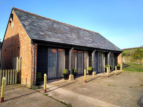 Barn conversion nestled in picturesque village.
