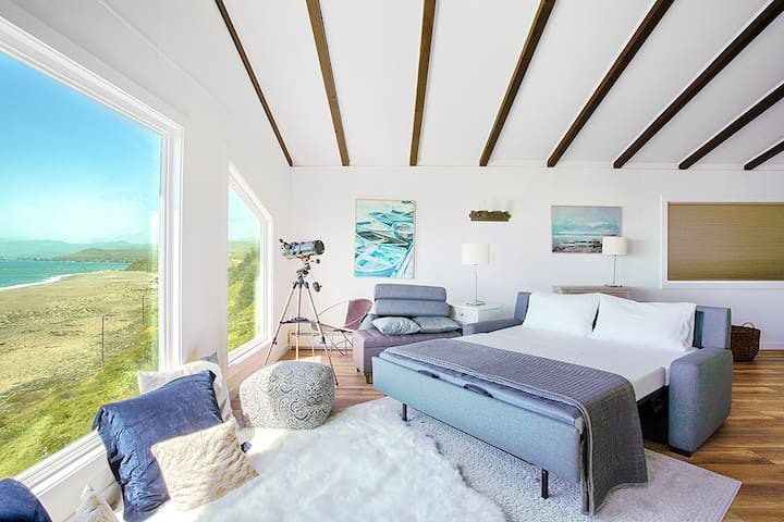 This is a large loft, not a full bedroom, meaning it does not have a door.