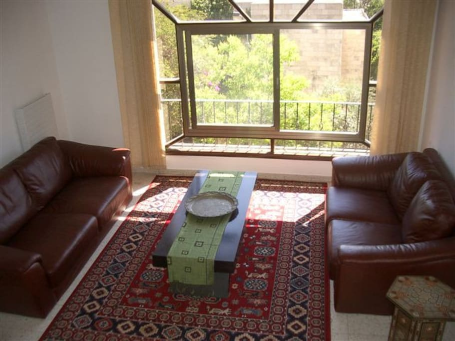 Living room with panaromic window has view of Temple Mount