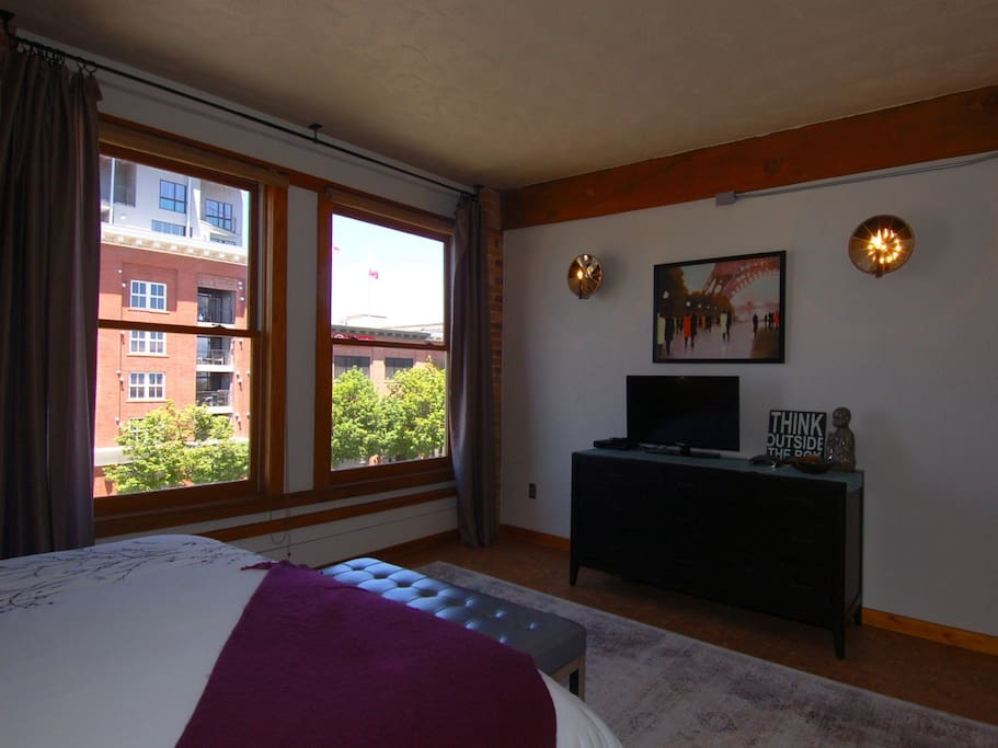Bedroom with HD TV and a view. Luxury bedding.