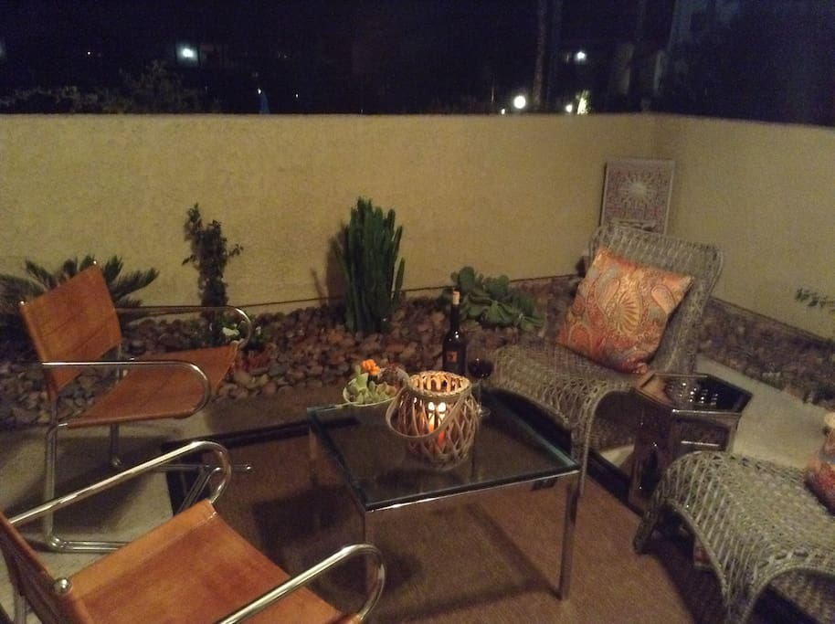 Spacious patio with mountain views overlooking pool, spa, and tennis courts.