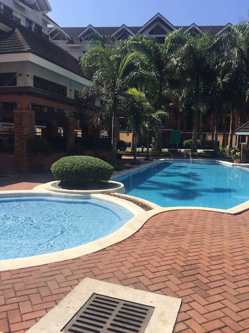Swimming pool adult and kiddie pool with Mini Playground besides the pool,