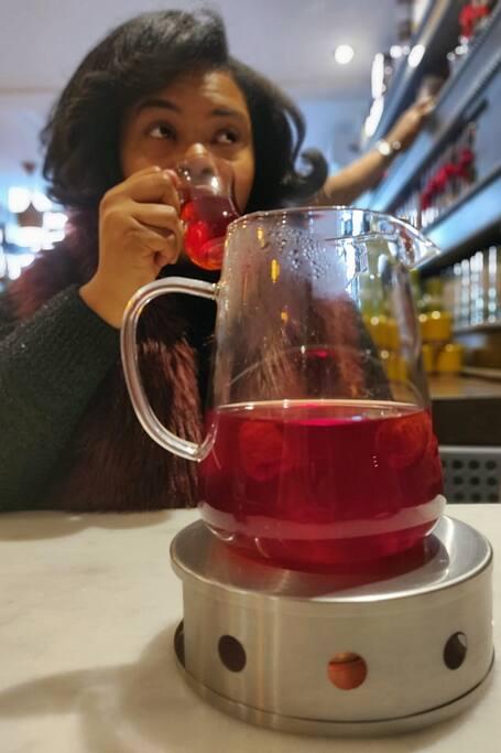 Your host drinking blood orange tea