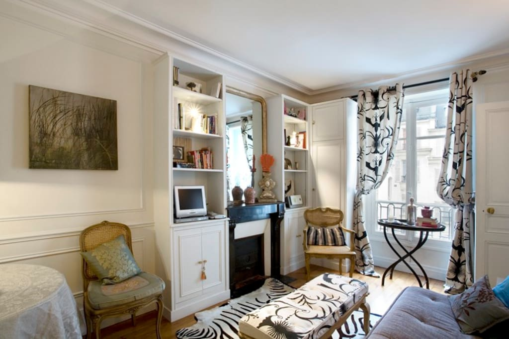 Main Salon with TV/cable/stereo, library, sitting and dining area.