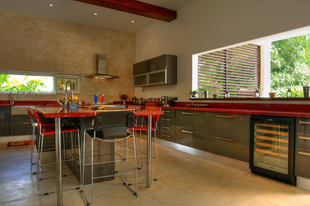 Modern Gourmet Italian inported kitchen with large center island and exterior counter top bar area.