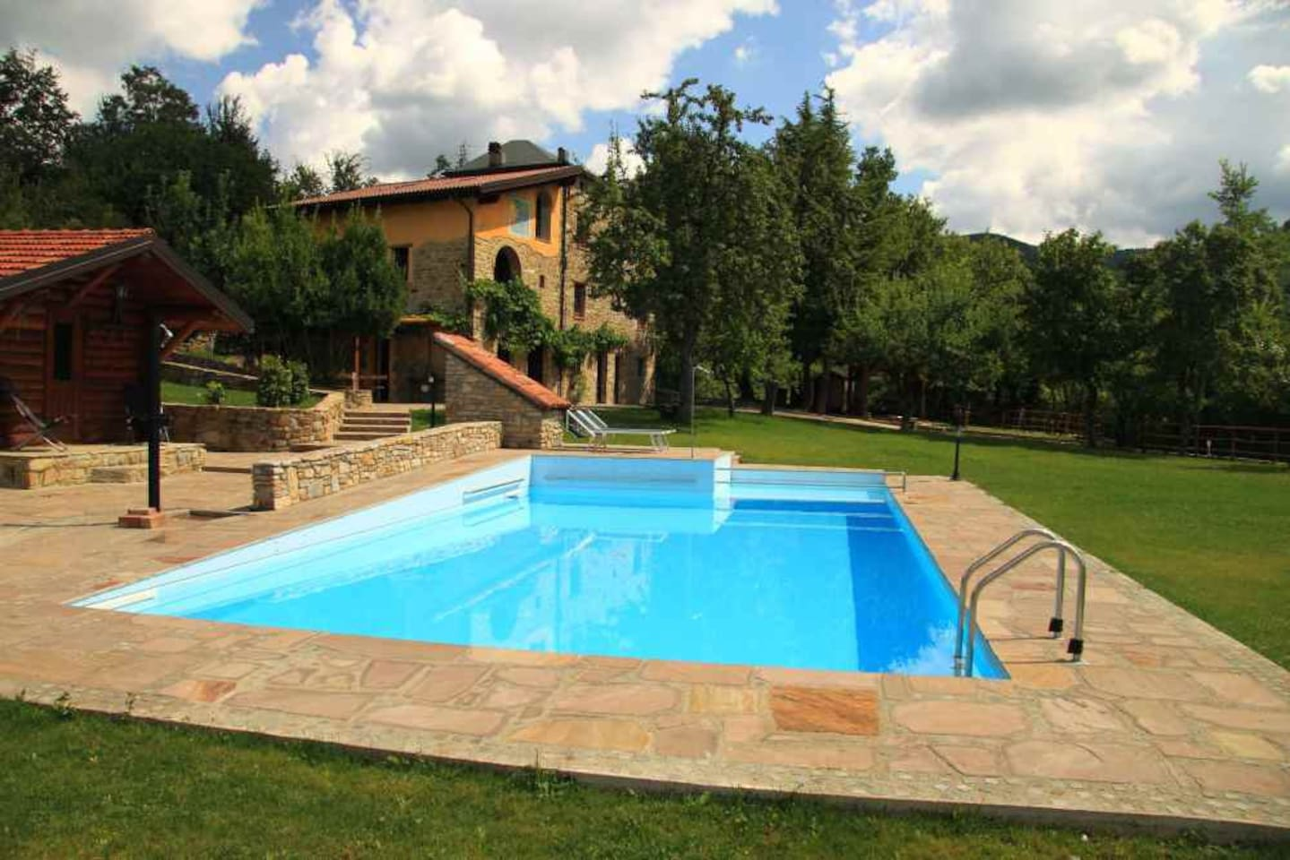 the pool and the stone house
