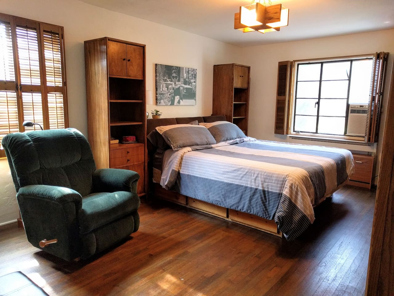 A spacious Master Bedroom cozy enough perfect for staying for a few weeks or months.