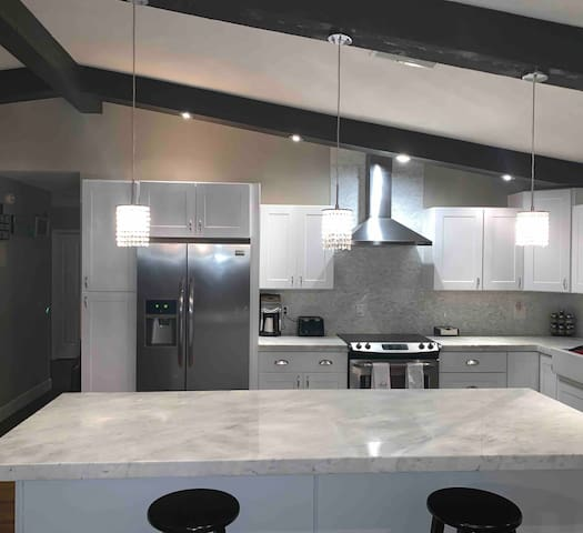 Bright open kitchen with huge island -ideal for serving!