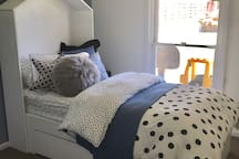 Fun and playful kids bedroom with king single bed, ceiling fan & light switch 100% block out blinds & comfy linen will keep the fussiest of sleepers asleep... maybe not, but I think it's a cool room!