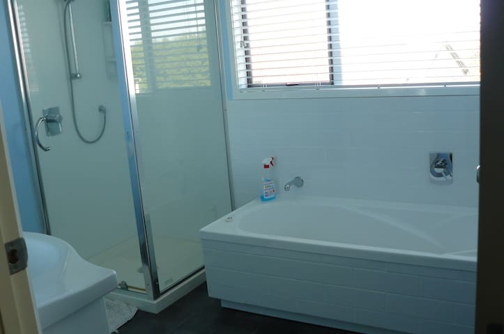 Lovely bathroom, good size shower, good pressure, bath, basin, toilet. For guests private use.