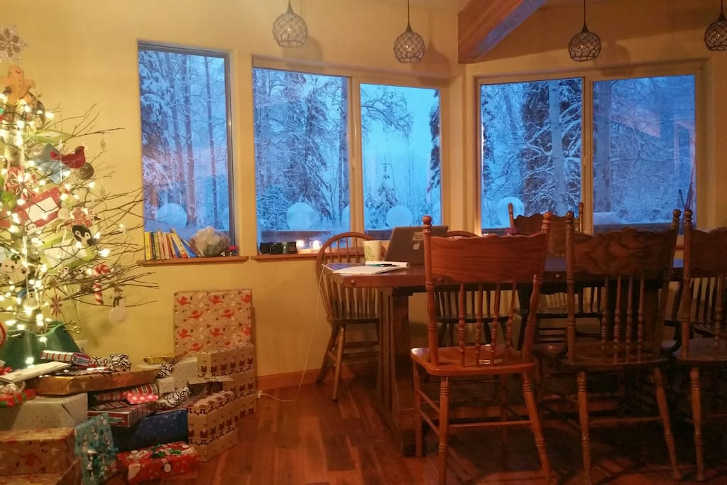 Living room with dining table looking out toward deck
