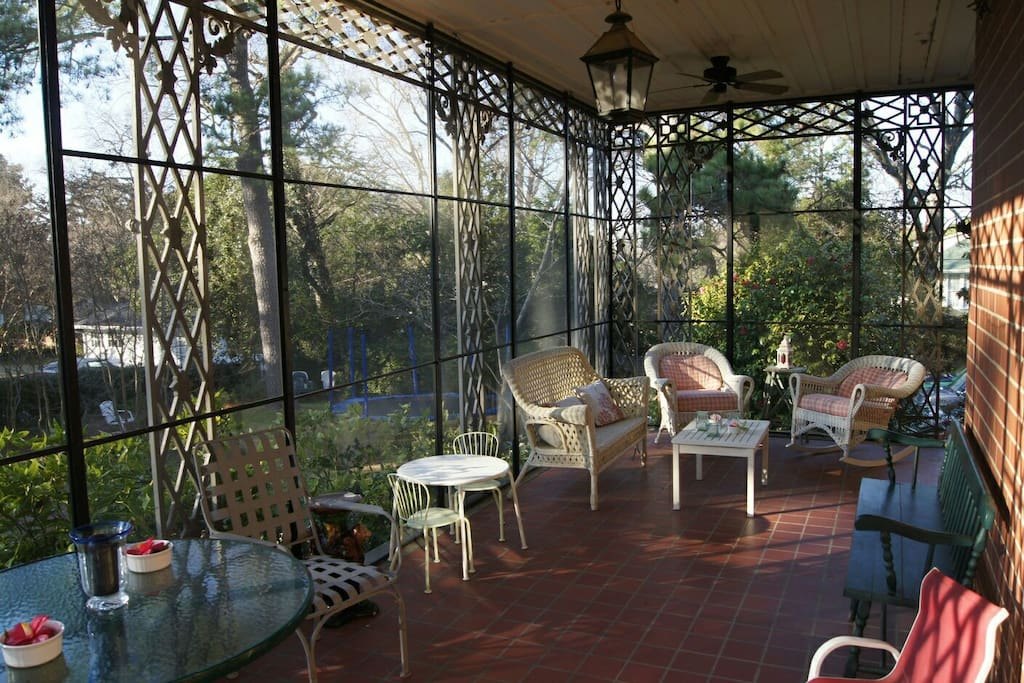 Screen porch is cozy for drinks and a good conversation.
