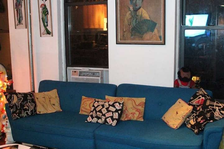 Couch view. 3 large windows with great light.