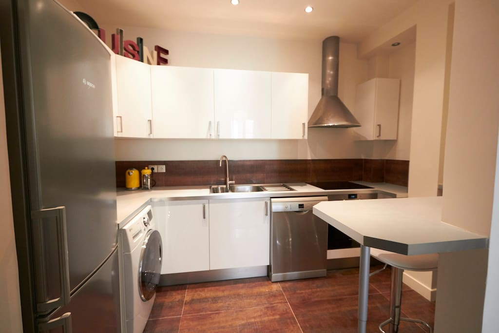 Large and complete kitchen with bar and 2 stools, dishwasher,  washer and dryer.