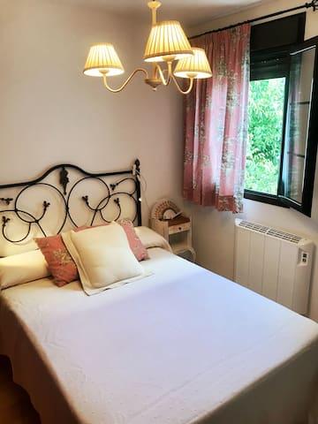Master room, window to a garden and Patio. Bathroom en suite. Comfortable double bed.
