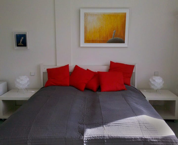 Sunny Guestroom with bathroom at artist's loft