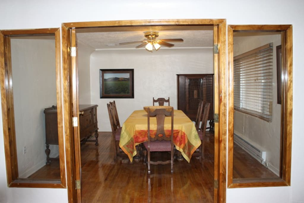 Gorgeous wood flooring throughout, french doors, beautiful dining room