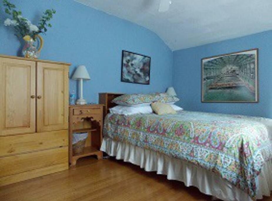 2nd floor - Blue Room: spacious,   w queen bed, desk, chairs, TV, bureaus, cross vent windows & ceiling fan.