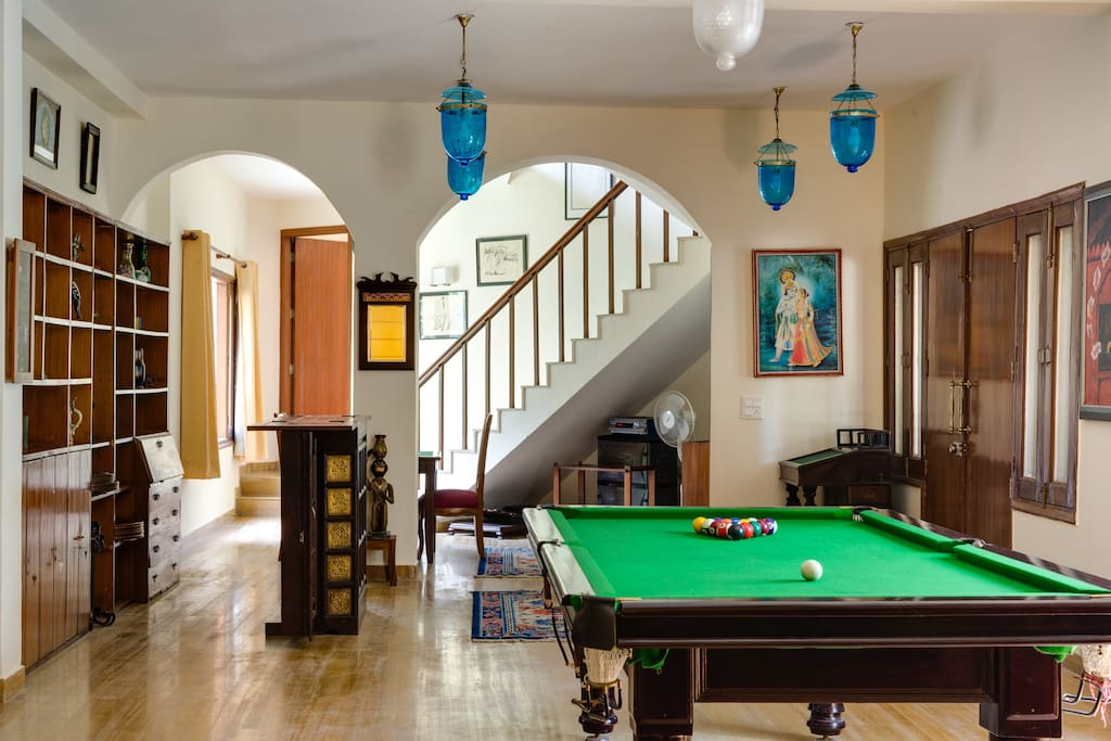 Living Room with mini library and pool table