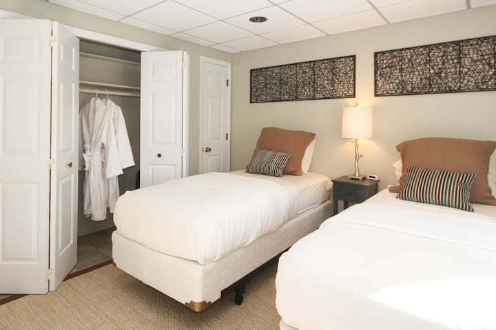 4th bedroom with extra long, king twin beds with 100% organic cotton Colton mattresses, closet with Turkish robes, and TV. The bath is just outside of the door.