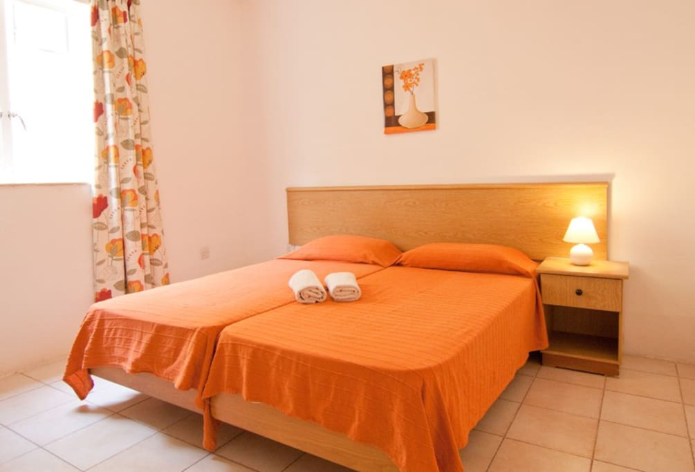 Clean and cosy bedroom sleeps 2 persons...also enjoys partial seaviews