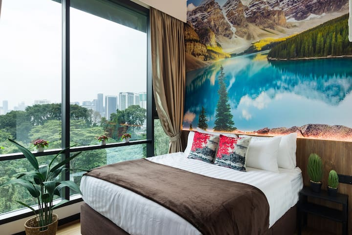 A hidden treasure - the view of the Canadian Rockies and   Lake Moraine backdrop design from our second bedroom is well-known and we're waiting for you to discover this sparkling blue gem!