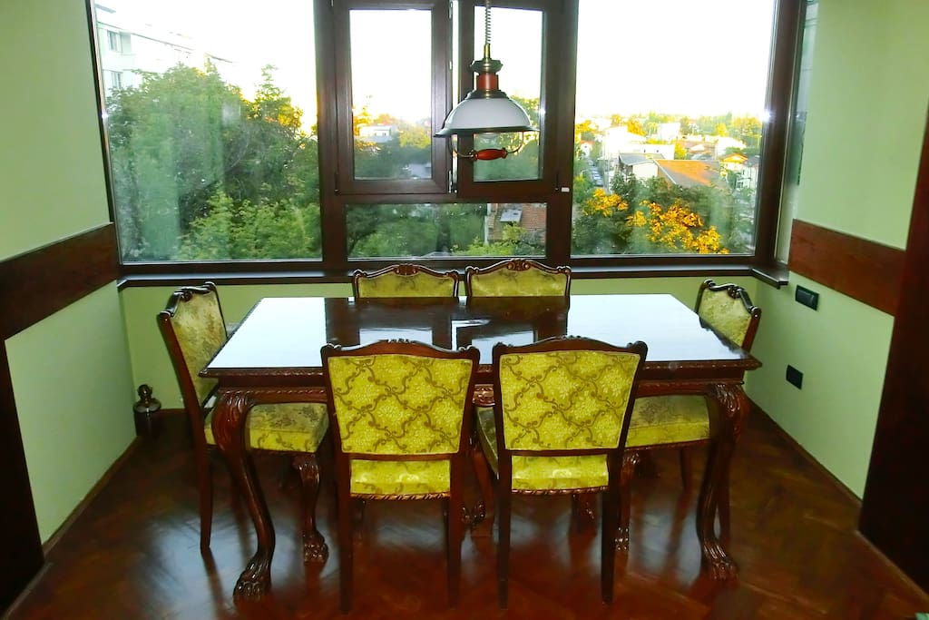 The former balcony now serves as dining space, with a great view, especially at sunset or in the winter.