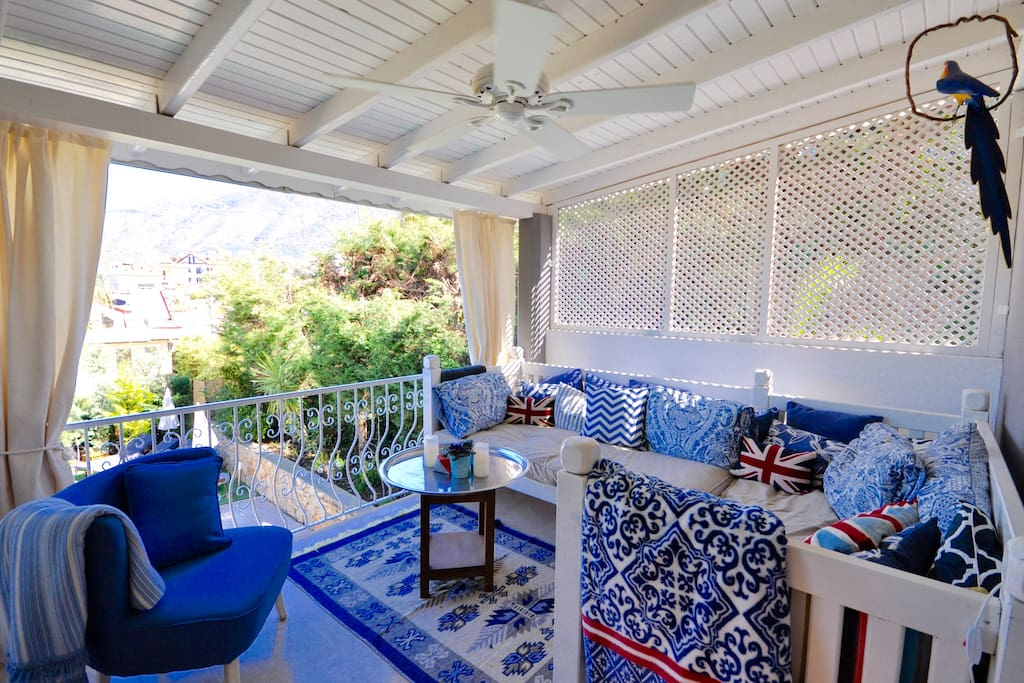 This veranda is cooled with silent fans. Perfect for drinks or a summer snooze.