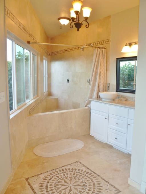Newly built Spa Shower, custom travertine mosaic.  Extra large area, with views of ocean from each window