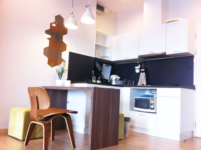 fully-equipped kitchen and dining table