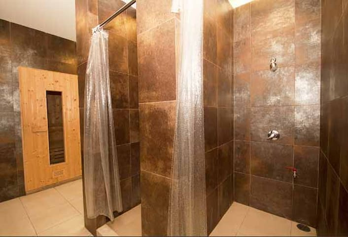 sauna and shower facility in the locker room by the swimming pool on floor 5 (membership in room rate)
