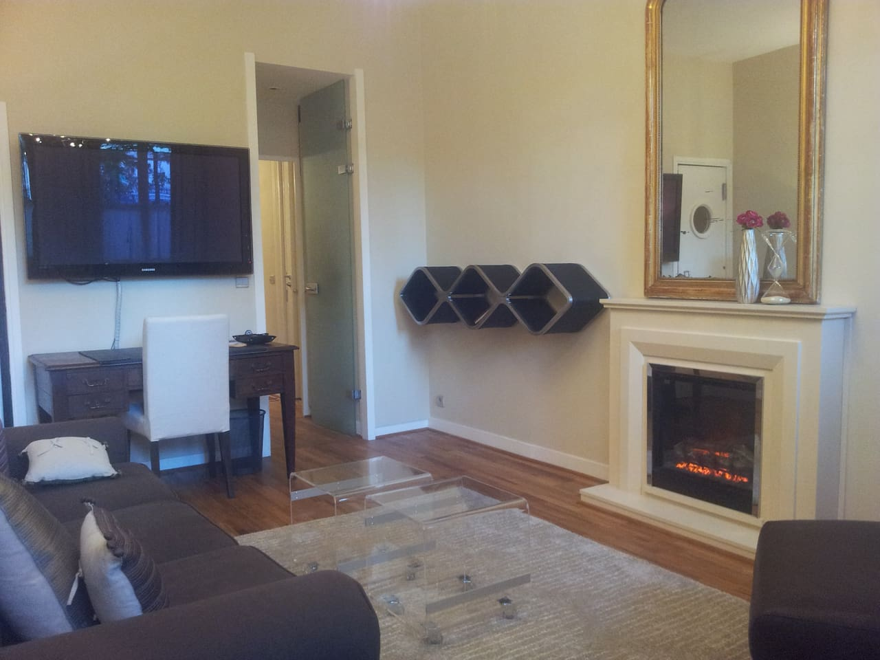 Living room with large TV and all video/computer connections avalable