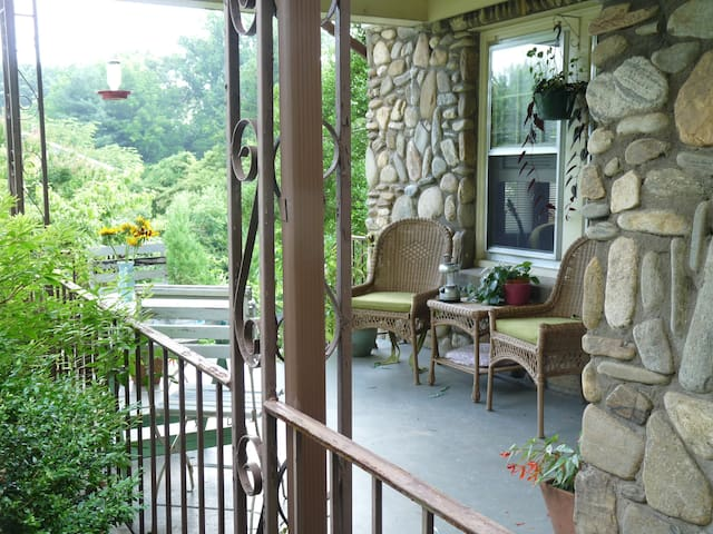Relax on the inviting front porch and watch the hummingbirds.