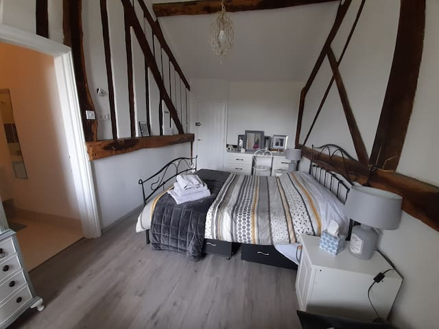 Double room with king size bed and ensuite shower room.
