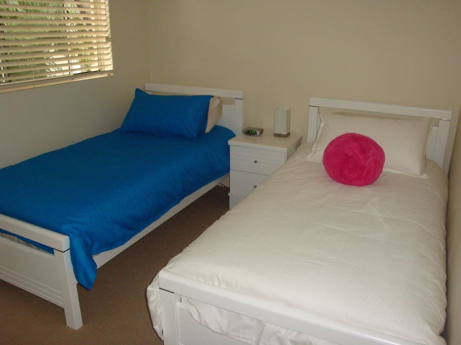 2 single beds in second bedroom
