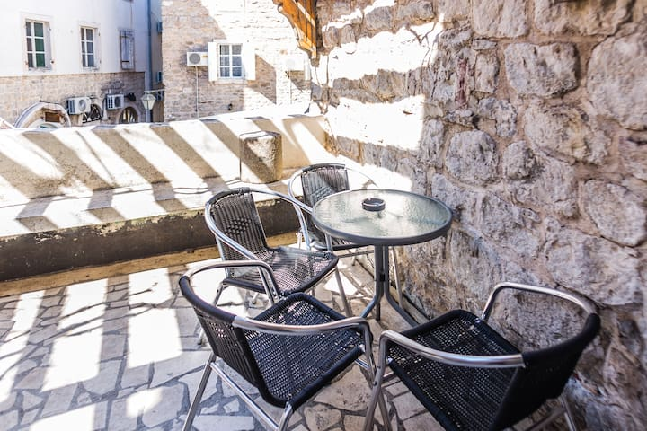 You can enjoy the morning coffee while overlooking the old town Budva.