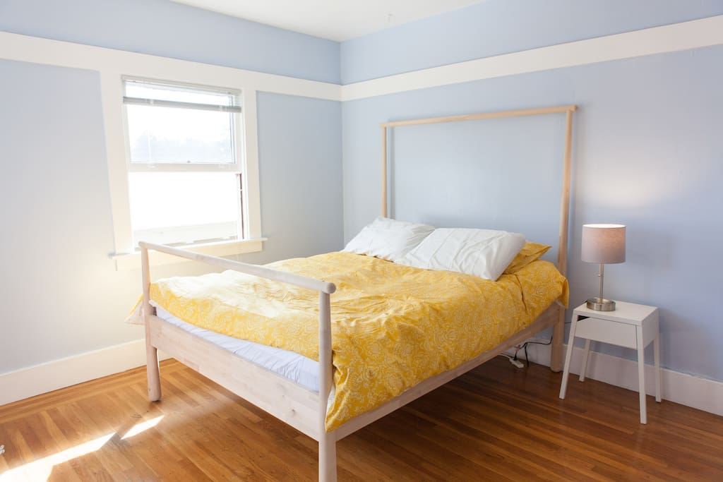 The blue bedroom with queen size Yogabed memory foam mattress
