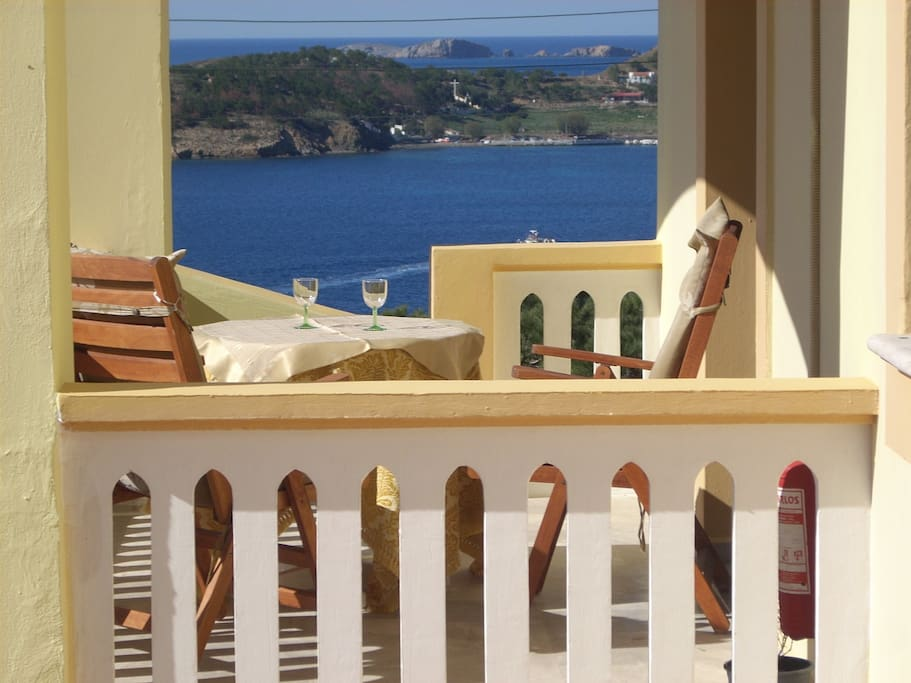 Large balcony/covered of honeymoon overlooking all the bay of Myrtie/Massouri and whole of the Telendos island.