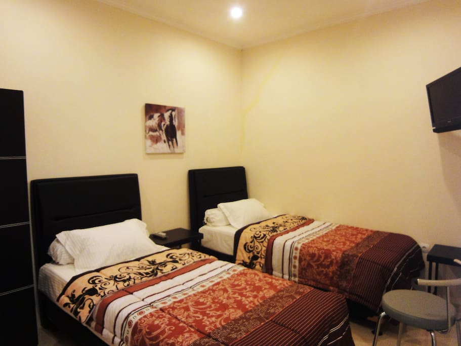 Twin beds for you and your buddy. With TV in rooms!