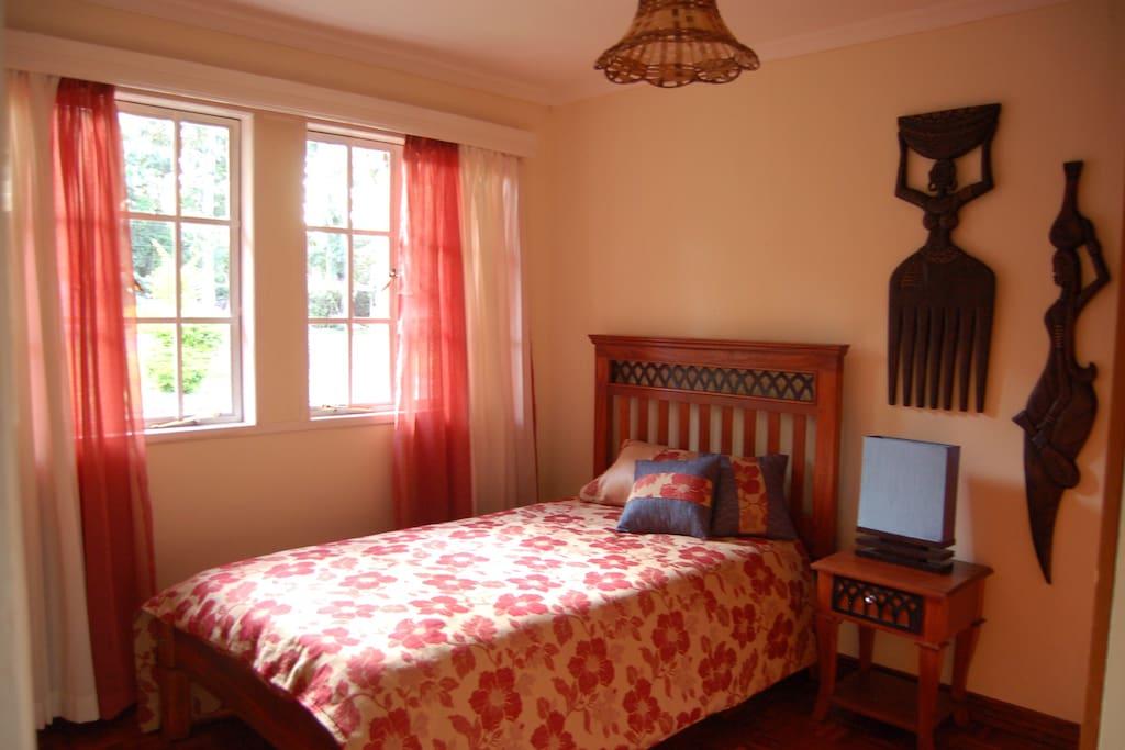 Kichana Room. King Single bed. High density spring mattress, cotton sheets and fibre pillows